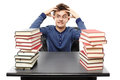 Angry Stressed Student Sitting At His Desk With Hands On The Hea Royalty Free Stock Image - 36547116
