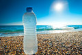 Bottle Of Cold Fresh Water On The Pebble Beach Royalty Free Stock Photo - 36547935