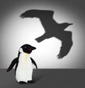 Penguin With Eagle Shadow. Concept Graphic Royalty Free Stock Images - 36566929