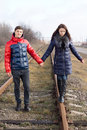 Courting Couple Playing On Deserted Rail Tracks Royalty Free Stock Photo - 36590405