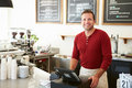 Customer Paying In Coffee Shop Using Touchscreen Royalty Free Stock Photography - 36599987
