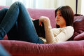 Young Beautiful Woman Lying On The Sofa And Reading Book Stock Photography - 36606602