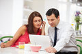 Couple Looking At Laptop Breakfast Royalty Free Stock Images - 36610719
