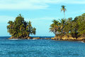 Rocky Islet Covered By Tropical Vegetation Stock Photos - 36625443