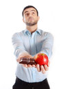Attractive Man Holding Chocolate And Apple Royalty Free Stock Photo - 36648935