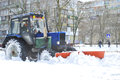 Tractor Cleans Snow On The Street Royalty Free Stock Photography - 36664367