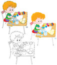 Boy Paints Easter Eggs Royalty Free Stock Photos - 36681098