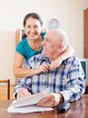 Happy Mature Couple Fills In Paper Questionnaire Royalty Free Stock Image - 36681776