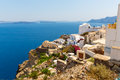 View Of Fira Town - Santorini Island,Crete,Greece. White Concrete Staircases Leading Down To Beautiful Bay Royalty Free Stock Photography - 36683367