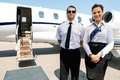 Stewardess And Pilot Standing Against Private Jet Stock Images - 36712254