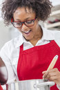 Mixed Race African American Woman Cooking Kitchen Stock Photography - 36729282