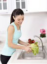 Beautiful Woman Washing Vegetables Stock Images - 36732634