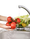 Beautiful Woman Washing Vegetables Stock Photos - 36732883