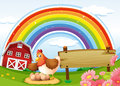 A Farm With A Rainbow And An Empty Signboard Royalty Free Stock Image - 36749056