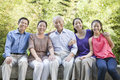Three Generation Family Sitting In Their Apartment Courtyard Stock Photo - 36763440