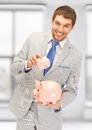 Man With Two Piggy Banks Royalty Free Stock Images - 36835109
