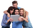 Excited Group Of Friends Reading Surprising Stuff On Their Table Stock Photography - 36841732