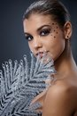 Seductive Woman With Silver Fan Royalty Free Stock Photo - 36843345