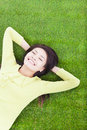 Smiling Woman Lying On The Grassland Royalty Free Stock Photo - 36915755