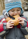 Child Eating Snack Outdoors Royalty Free Stock Photography - 36923157