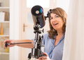 Beautiful Woman Looking Through Telescope Royalty Free Stock Image - 36938776
