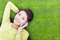 Pretty Girl Talking Over The Phone In A Meadow Royalty Free Stock Images - 36944959