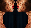 Fantasy. Two Women S Faces With Tracery Opposite Each Other. Reflexion Royalty Free Stock Image - 36957226