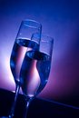 Champagne Flutes On Bar Table On Dark Blue And Violet Light Background Stock Photography - 36969232