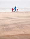 Woman And Two Small Children On Winter Beach Stock Image - 36976821