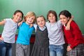 Cute Schoolchildren With Arms Around Standing Royalty Free Stock Image - 36985186