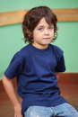 Cute Little Boy Sitting In Classroom Royalty Free Stock Images - 36987269