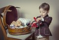 Vintage Portrait Of Boy Playing With Tin Toys Stock Photos - 36988473