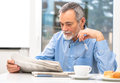 Senior Man With Newspaper Royalty Free Stock Photography - 36989637