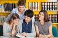 Female Student With Friends Reading Book In Royalty Free Stock Images - 37005379