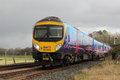 Diesel Multiple Unit Train At Arnside In Cumbria Stock Photography - 37052522
