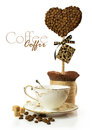 Coffee Cup With Hand Made Topiary Of Coffee Beans Royalty Free Stock Photography - 37055017