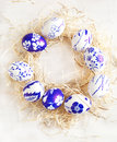 Easter Egg Wreath On A White Wooden Background. Stock Photo - 37098690