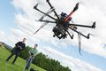 Male Engineers Operating UAV Helicopter Royalty Free Stock Photos - 37104248