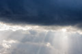 The Rays Of The Sun Behind The Clouds Stock Image - 37109411
