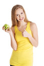 Beautiful Causal Caucasian Woman Holding Fresh Green Apple With Royalty Free Stock Photos - 37125658