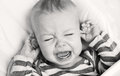 Cute Little Boy Crying Holding His Ear Royalty Free Stock Photography - 37128287