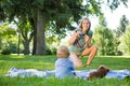 Mother Taking Picture Of Baby Boy In Park Royalty Free Stock Photography - 37129397