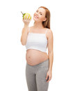 Happy Future Mother With Green Apple Stock Image - 37153091