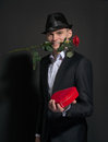 A Young Man With A Rose In His Teeth Holding A Box Of Chocolates Stock Images - 37167734
