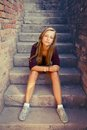 Sad Girl With Blue Eyes Sitting At Stone Brick Stairs Stock Photography - 37170322