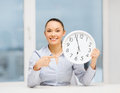 Attractive Businesswoman With White Clock Royalty Free Stock Image - 37172526