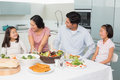 Family Of Four Enjoying Healthy Meal In Kitchen Stock Photography - 37197492