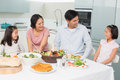 Cheerful Family Of Four Enjoying Healthy Meal In Kitchen Stock Photo - 37197500