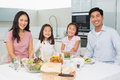 Happy Family Of Four Enjoying Healthy Meal In Kitchen Stock Image - 37197641