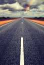 Long Straight Road With Gathering Storm Clouds Stock Photo - 37216390